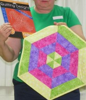 """Beverly shares her """"Quilting Designs"""" used on her pretty geometric table mat."""