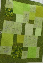 """Kay's """"Frogs"""" quilt for her grandchild."""