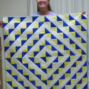 Check out this pretty blue/yellow baby quilt made by Alice Allinson.