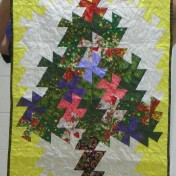"Mary Shoaff's finished ""Twister Tree"". Last month she showed the panel before the ""twister"" part was done."