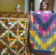 "Tied for First place: (L-R) Mary Magruder, ""Pineapple Blossom"" and Andrea OBrien, ""Scrappy Mountains""."