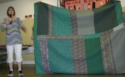 """(Trunk Show, quilt made by Bonnie) Bonnie talks about the back of """"Jared Takes a Wife""""."""