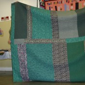"(Trunk Show, quilt made by Bonnie) Bonnie talks about the back of ""Jared Takes a Wife""."