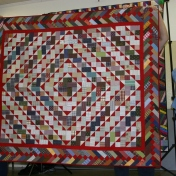 "(Trunk Show, quilt made by Bonnie) ""Bricks in the Barnyard"" by Bonnie, from ""Scraps and Shirttails II"