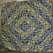 "(Trunk Show, quilt made by Bonnie) ""Jamestown Landing""."