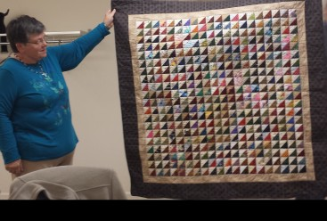 Kay Beach and her Triangle Challenge quilt.