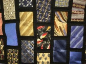 A closeup of Elsie's Tie Quilt.