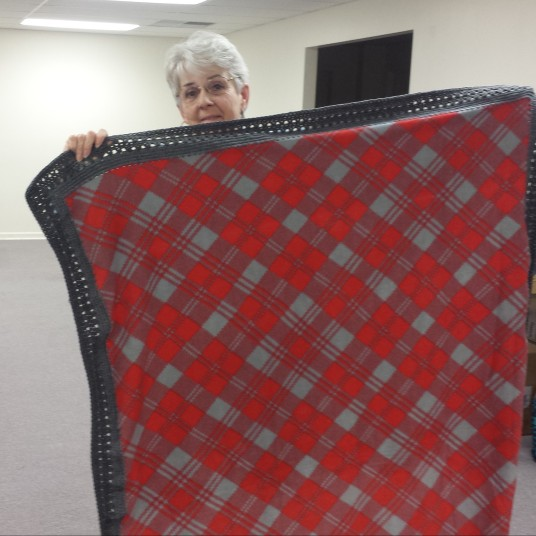 Bonnie Schultz and her Project Linus quilt.