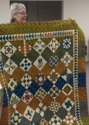 This is a Moda Sampler shuffle quilt made by Linda.