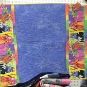 Peggy used great fabric for this charity quilt.