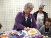 Peggy Clark came with a PILE of quilts!