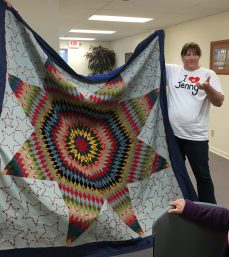 "Maria and her mother made lots of quilts together. This one is a ""Lone Star""."