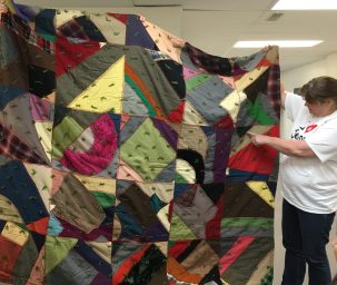 "This ""Crazy Quilt"" is tied with yarn."