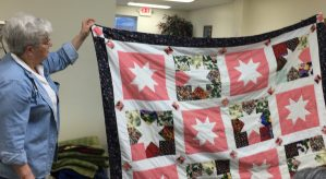 Bonnie Schultz's pretty quilt made from charm packs.