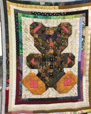 "Bonnie Schultz's cute scrappy ""Teddy Bear"" quilt."