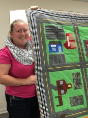 April Bartlett and her darling quilt for her son.