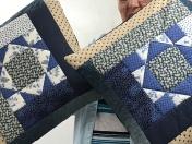 Mary's pillows made from sampler blocks.