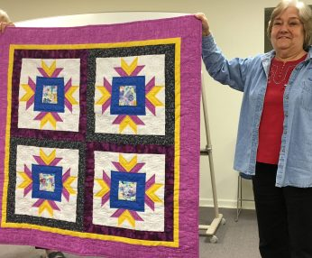 Joan with quilt from Shelly's workshop.